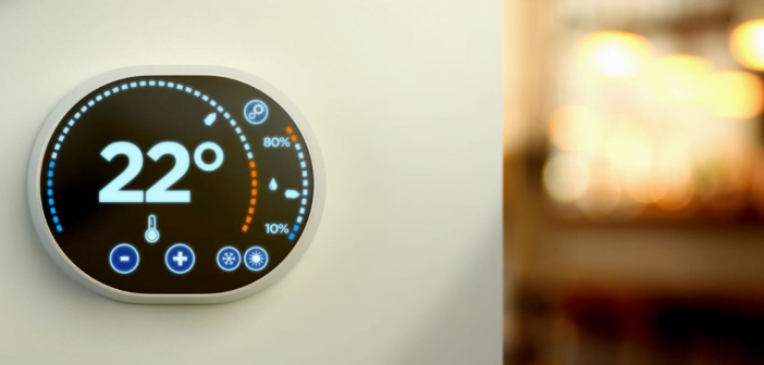 illustration thermomètre connecté, écran de contrôle sur un mur qui affiche la température